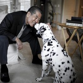Sam Han pets his family dog Oreo in his daughter's home in Pasadena, Calif., Monday, Nov. 22, 2010. Separated from his family during the Korean War, Han was sheltered by strangers until an unlikely meeting set him on a remarkable journey to the United States. He was adopted by a Minnesota professor, immigrated under a special bill from Congress and years later became a successful business executive. Han, a 65-year-old cancer patient, wants to give other overseas orphans a shot at making a life for themselves, but there are plenty of obstacles and so much to do. (AP Photo/Jae C. Hong)